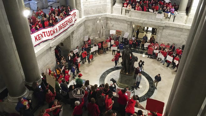 Hundreds of Kentucky teachers protest outside Gov. Matt Bevin?s office in Frankfort Friday. State lawmakers passed a bill late Thursday night that makes changes to the state?s pension system.