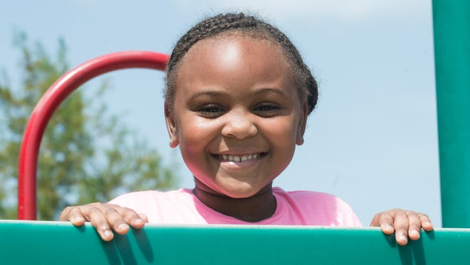 Ne'Cori Gardner, 5, plays at Vaughn Road Park in Montgomery on Wednesday, July 8, 2015.  She and her brother, Ken'Cory Gardner, 4, are two of the 86 children who became ill from food poisoning at Sunny Side Day Care Center. The mom has filed a lawsuit against the owners of the center.