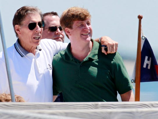Former U.S. Sen. John Tunney (left) is pictured standing