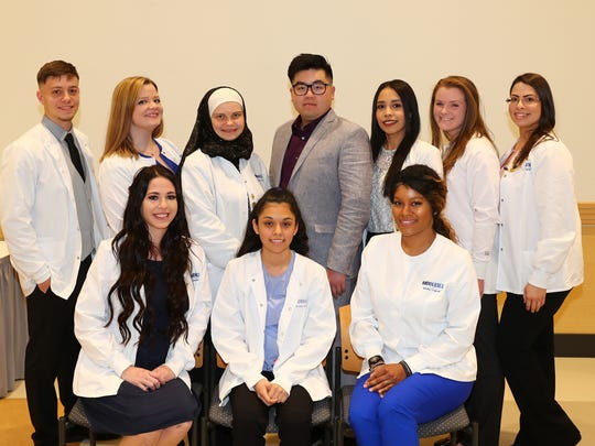 Ten Middlesex County College students were recently inducted into Delta Omicron, an honor society for nursing students. The society is open to excellent second-year nursing students who design and implement a community service education or recruitment project. Seated, from left: Victoria Szabo of Monmouth Junction, Gisselle Hernandez of New Brunswick, Jamirah Turner of Somerset. Standing: Eitan Fabia of Edison, Hannah Goodson-Foulk of Hamilton, Katsiaryna Sikorskaya of East Brunswick, Jang Youp Lim of East Brunswick, Lisnatiel Diaz of Perth Amboy, Katelyn Walczak of South Amboy and Zenaida Perez of Somerset.