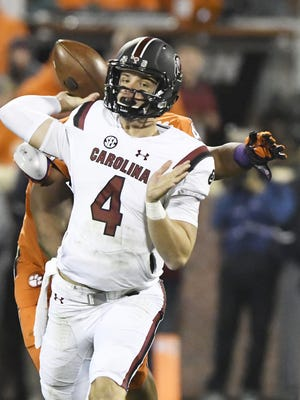 South Carolina quarterback Jake Bentley (4) gets off a pass against Clemson.