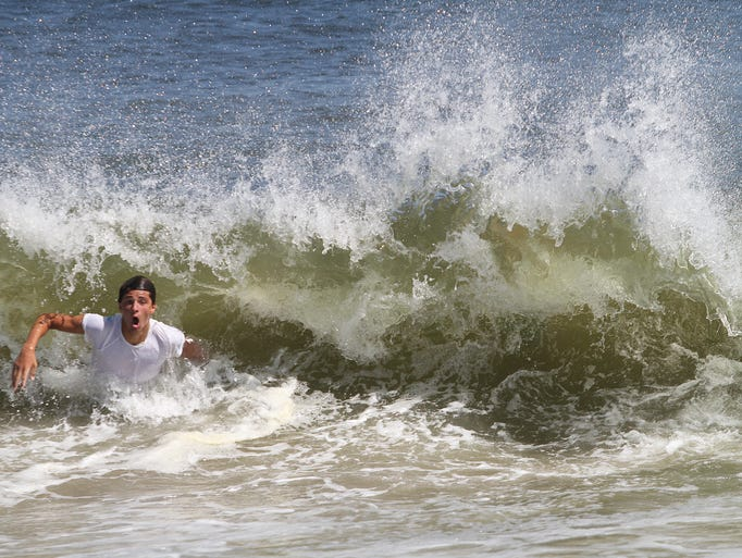 ASB 0829 SB RIP CURRENTS   John Dardis, 15, of Warren, NJ, reacts to a wave as Hurricane Cristobal churns up rough surf and rip currents along the beach in Sea Bright, Thursday, August 28, 2014. Mary Frank/Staff Photographer