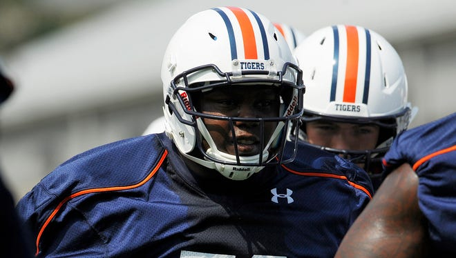 Auburn guard Devonte Danzey says he'll start the Birmingham Bowl Wednesday at center in place of the injured Austin Golson.
