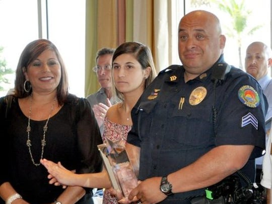 Police Sgt. Hector Diaz receives the 2014 Police Officer