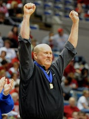 MOLLY BARTELS / Courier & Press archives Memorial head coach Bruce Dockery celebrates after the team's 58-50 overtime win over Benton Central during the 2011 Class 3A girls' basketball state championship game at the Allen County War Memorial Coliseum in Fort Wayne.