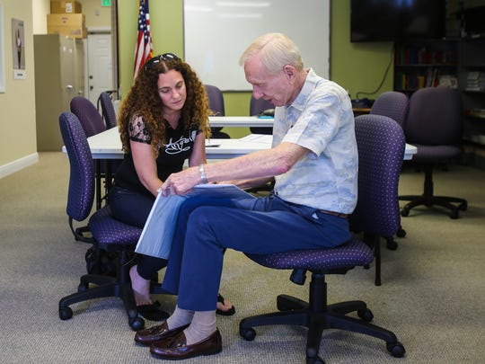 Aty Gonzalez, 38, left, prepares for her citizenship exam with help from Bill Nichols, 78, on Wednesday, July 19, 2017, at the Literacy Volunteers of Collier County offices.