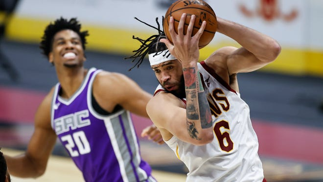Cavaliers center JaVale McGee (6) grabs a rebound next to Sacramento Kings' Hassan Whiteside (20) during the Kings' 119-105 win Monday night. McGee has been rumored as a possible trade chip for the Cavs ahead of Thursday's NBA trade deadline. [Ron Schwane/Associated Press]