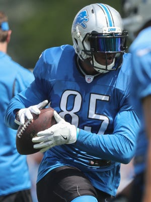Detroit Lions tight end Eric Ebron catches passes during training camp July 31, 2016, in Allen Park.