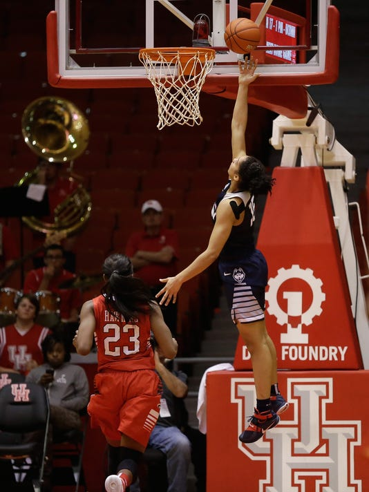 Connecticut guard Gabby Williams, right, drives to the basket for a layup past Houston guard Serithia Hawkins (23) during the second half of an NCAA college basketball game Friday, Jan. 8, 2016, in Houston. (AP Photo/Bob Levey)