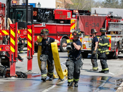Fire reported in wauwatosa at red dot emergency personnel work the scene of a fire inside publicscrutiny Choice Image