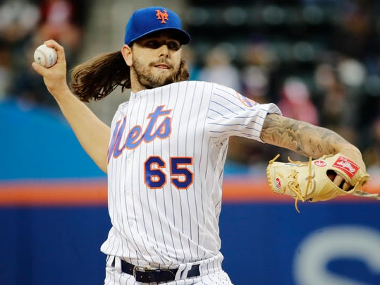 New York Mets' Robert Gsellman delivers a pitch during the first inning of a baseball game against the Miami Marlins, Saturday, May 6, 2017, in New York. (AP Photo/Frank Franklin II)