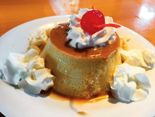 Flan ($4.50) came topped with whipped cream and a cherry for dessert.