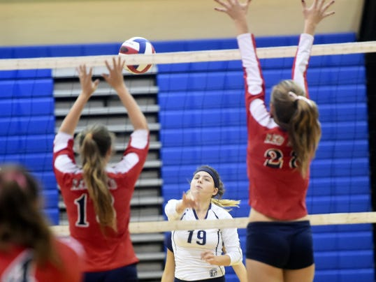 Chambersburg's Kailey Layman (19) spikes the ball against Red Land on Tuesday.