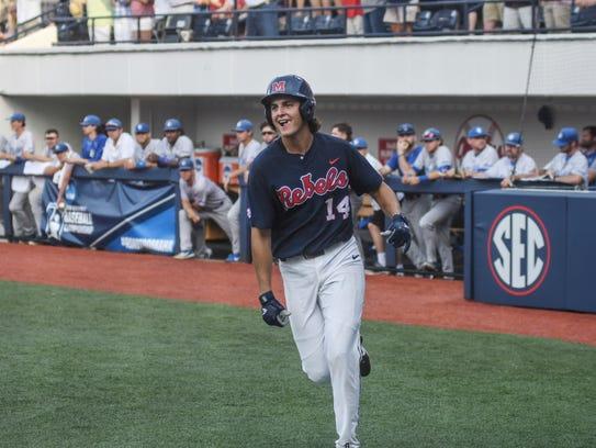 Mississippi's Cole Zabowski (14) smiles after scoring
