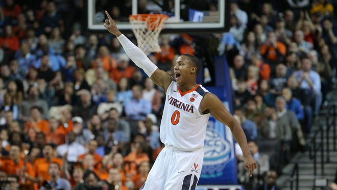 Virginia Cavaliers guard Devon Hall (0) reacts during the first half of the ACC championship game.