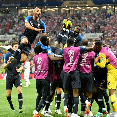 French players celebrate after Kylian Mbappe scored