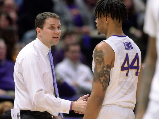 LSU coach Will Wade greets forward Wayde Sims (44) as he returns to the bench during the team's NCAA college basketball game against Texas A&M, Tuesday, Jan. 23, 2018, in Baton Rouge, La. (Hilary Scheinuk/The Advocate via AP)