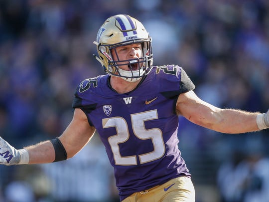 SEATTLE, WA - OCTOBER 20:  Linebacker Ben Burr-Kirven #25 of the Washington Huskies reacts after making an interception in the fourth quarter against the Colorado Buffaloes at Husky Stadium on October 20, 2018 in Seattle, Washington.  (Photo by Otto Greule Jr/Getty Images)