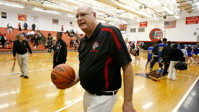 PRP head coach Dale Mabrey carried the game ball off the court (as he does frequently) after defeating Valley during their game at PRP High School.  This win made Mabrey the winningest high school coach in Louisville history.  Feb. 25, 2015