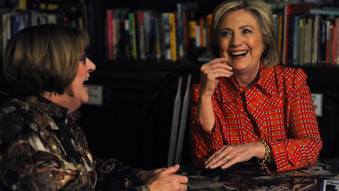 Democratic candidate for president Hillary Clinton, right, sits down for a meeting with Democratic Party Chair Marty McGarry at the Comma Coffee shop during a campaign visit to Carson City on Monday, Nov. 23, 2015