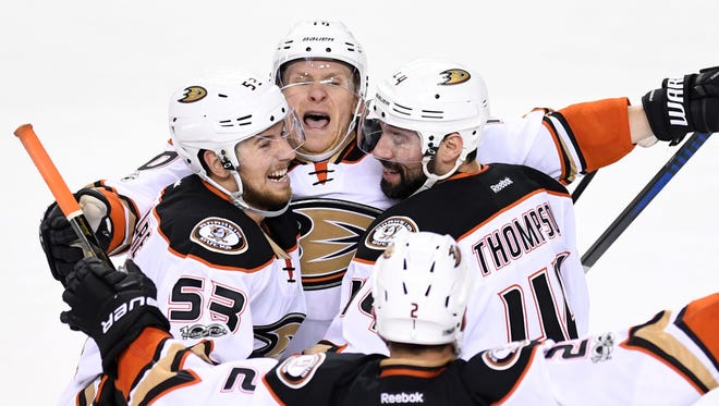 Anaheim Ducks defenseman Shea Theodore (53) celebrates his third-period goal with right wing Corey Perry, who scored the winner in overtime.