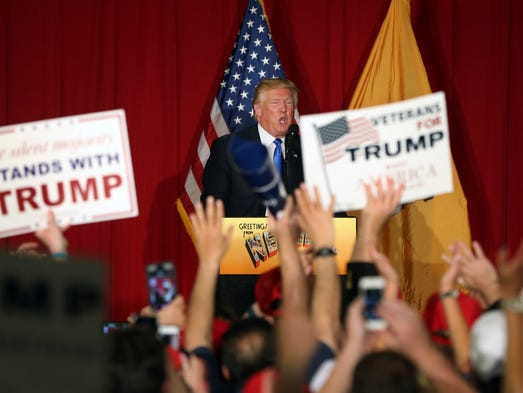 Supporters wave signs as Republican presidential candidate