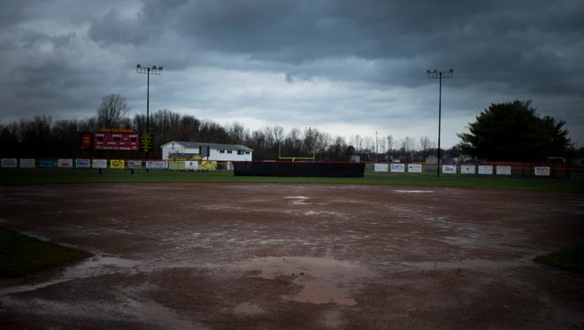 Mater Dei Softball Field collects water as a new batch of storms pass overhead Tuesday afternoon. Heavy rains and even snow have been responsible for keeping area baseball and softball teams from getting their games in so far this season.