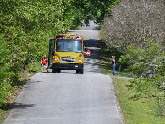 A school bus makes its way down Phillips McCall Road in Greer on Thursday, May 3, 2018. It is among the county's nearly 1,700 miles of county-owned and maintained roads.