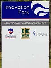 The sign at Innovation Park lists Revolution Aluminum and partner companies that would support a proposed aluminum mill's operations.
