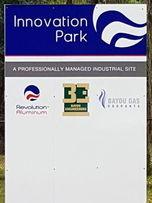The company that plans an aluminum mill complex at the Innovation Park property in Pineville has reached a deal to pay its creditors.