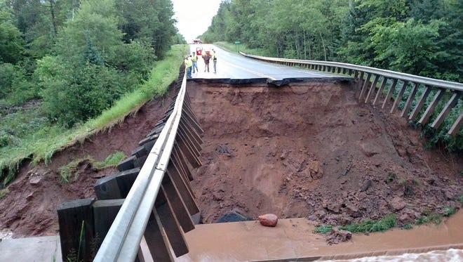 Highway 63 is washed out in the Town of Grand View in Bayfield County in July 2016 due to heavy rains. More flooding is predicited with climate change. State emergency planners posted information online last week on climate change planning.