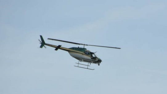 Officials say the Brevard County sheriff's helicopter along with police dogs assisted with tracking three suspected burglars in Melbourne