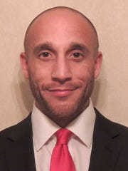 Brian Thomas Jackson, a Democratic candidate for the Ingham County prosecutor's seat, is seen in this undated photo provided by the candidate.