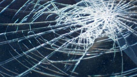 Broken glass in car file photo.