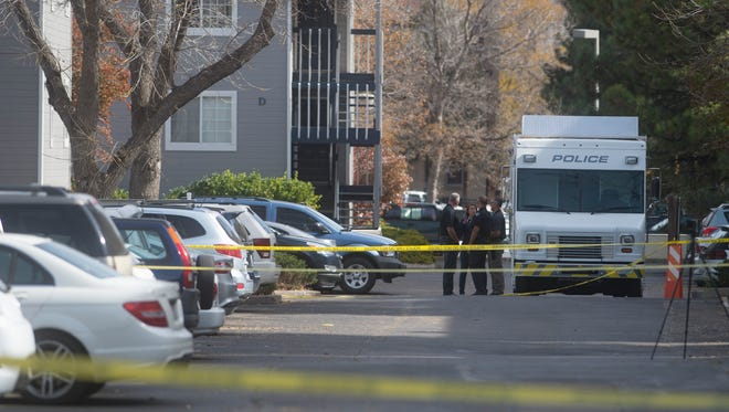 Fort Collins police respond to the scene of a fatal shooting investigation at 720 City Park Avenue on Thursday, October 19, 2017.