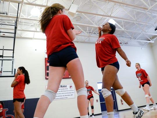 Kaylyn Woods, right, celebrates near teammate Christina