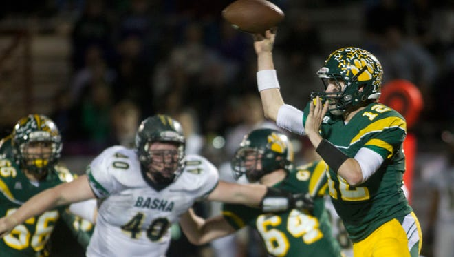 Horizon quarterback Dalton Sneed throws during the 4th quarter of the first round of Division I football playoffs against Basha at Horizon High School in Phoenix.