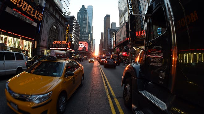 Traffic slows on 42nd Street in New York.