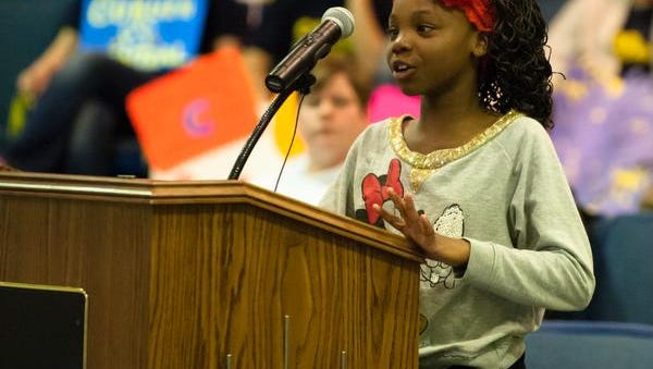 Dre-Leah Burton speaks to the Battle Creek Public School Board in opposition to the school closing proposals at a meeting in April.