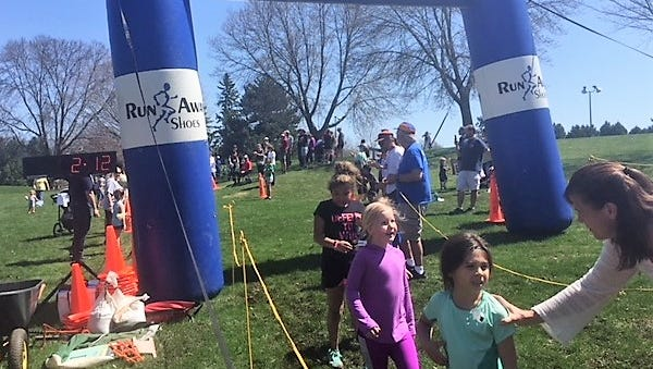 Kids cross the finish line at the 2018 'It's Fun to Run' race held in Fond du lac.