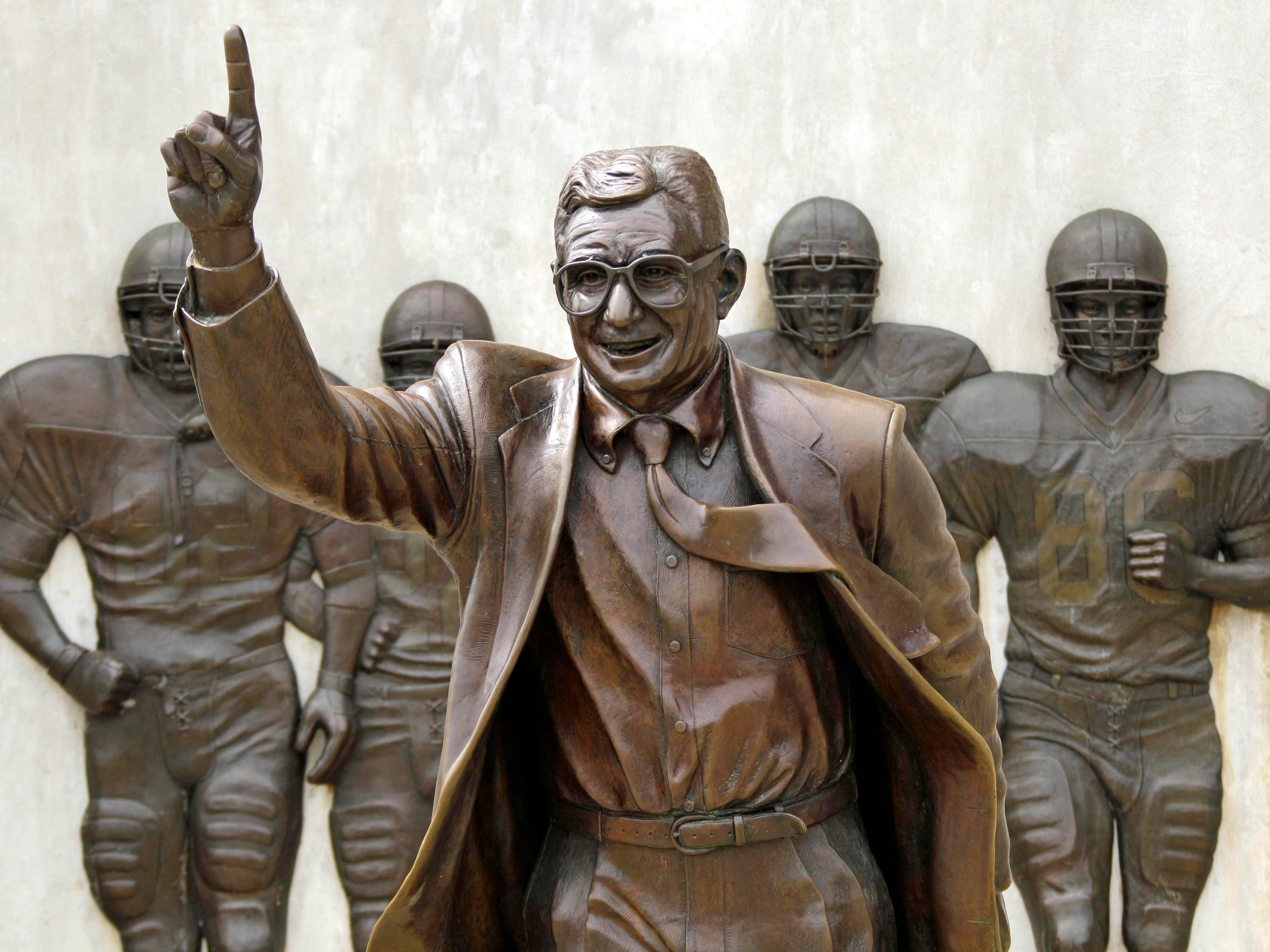 A statue of Joe Paterno has been removed from campus. His 110 wins that were vacated in 2012 could be restored as part of settlement talks in a lawsuit.