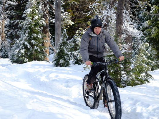 Zach Urness fat bikes the Todd Lake snowshoe trail near Dutchman Flat Sno-Park west of Bend.