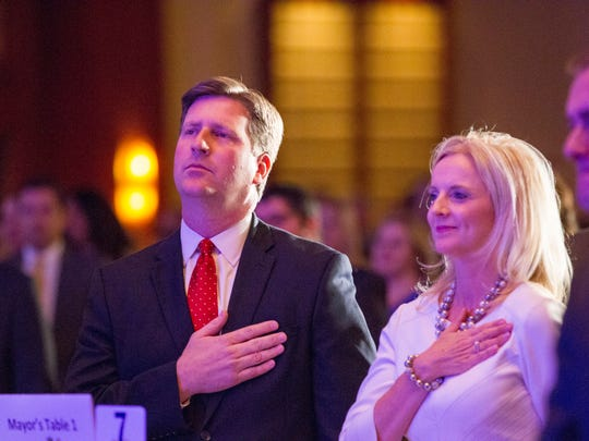 Phoenix Mayor Greg Stanton and his wife Nicole say the Pledge of Allegiance before the mayor's  fourth State of the City  on April 8, 2015.