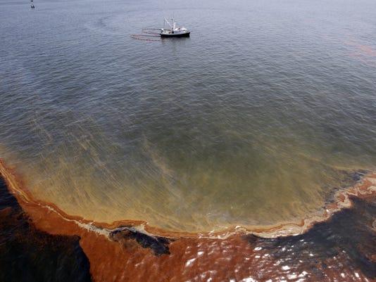 635652343652312144-PNJBrd-04-18-2015-NewsJournal-1-A006-2015-04-17-IMG-Gulf-Oil-Spill-Photo-3-1-HBAHBO3B-L597689147-IMG-Gulf-Oil-Spill-Photo-3-1-HBAHBO3B