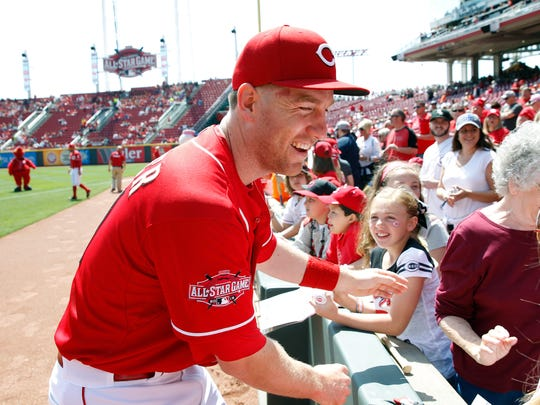 The Reds' Todd Frazier smiles after taking photos with fans before Wednesday's game against the Brewers at GABP.