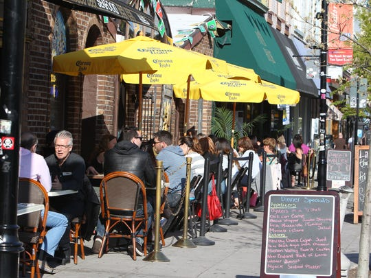 Restaurants set out sidewalk tables on Main St. in