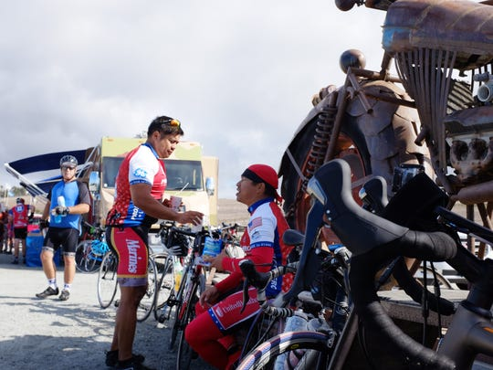 Fueling up by J & S Surplus' giant motorcycle on Hwy 1, veterans take a break during Day 2 of the week-long Ride 2 Recovery 2015 California Challenge.