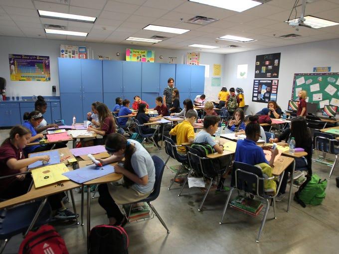 Mustafa Ay's 6th grade class creates model atoms at
