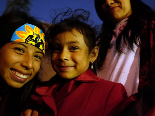 Children enjoy the traditional atmosphere of Friday's Day of the Dead celebration in east Salinas.