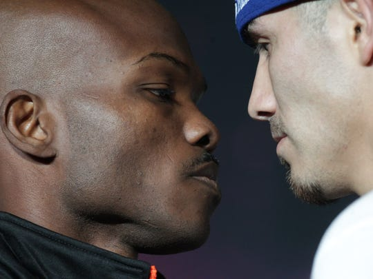 At left, Timothy Bradley Jr. weighs in at 146 pounds and is under the 147 limit as a welterweight. His opponent, Brandon Rios was over the weight limit at 147.2 pounds and will have to try to shed the extra .2 in an hour. In this photo they do the last face-off before they meet in the ring at the Thomas and Mack Center in Las Vegas, Nevada on November 7, 2015.